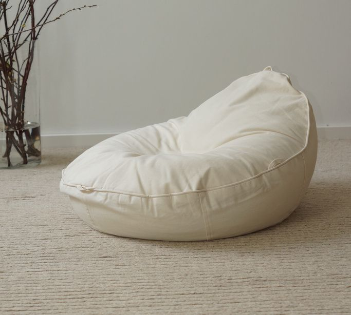 hochwertiger Baby Sitzsack ergonomisch in creme aus Öko Baumwolle und Bio Dinkelspreu